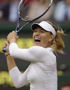 Maria Sharapova of Russia plays a return to Kristina Mladenovic of France in their Women's first round singles match at the All England Lawn Tennis Championships in Wimbledon, London, Monday, June 24, 2013. (AP Photo/Anja Niedringhaus)
