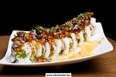 Since Mikuni has been innovating fresh Japanese dishes and serving eclectic sushi in a lively dining experience. Spicy Crab Sushi Roll Recipe, Sushi Roll Recipes, Eel Recipes, Asian Recipes, Cooking Recipes, Sushi Take Out, Eel Sushi, Onigirazu, Wraps