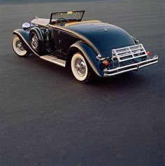 The 1936 Duesenberg Model SJ Convertible Coupe Body by Rollston has a supercharged engine with a claimed output of 320bhp. This allowed most SJ's to exceed 130 mph. A car for the ages.