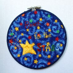 Reach for the Stars is an encouragement to children of all ages. It is stitched in bright rainbow colors to bring excitement and cheer to 'reach for the stars' in life.   This 6 in hoop is hand stitched with felt details hand sewn on. It features a finished felt back, ribbon wrapped edge, and a rib