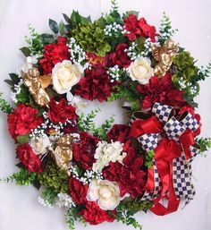 "The wreath is embellished with lots of greenery, beautiful red Peonies, red Roses, red Dahlias, cream Roses, green/red Hydrangeas and white Baby breaths. The wreath is accented with three gold Cherubs. I finish the wreath with a high-end black and white check and red Ribbon Bow.   The wreath measures from tip to tip at 26"" (L) x 26"" (W) x 7.5""(D)."