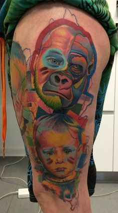 Gorilla and baby tattoos on the left thigh.