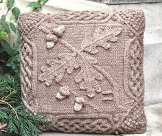 Celtic Oak Pillow by Barb Pott in her Celtic Botanical Knits series -- the oak leaves are knit each in one piece and appliqued on. the bobbles at the corners cover the holes from short rows.