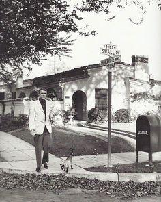 Cary Grant walking his cat in LA.