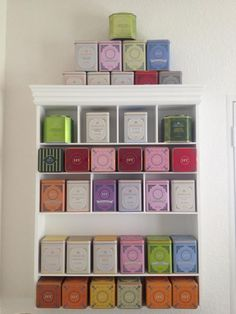 I want a tea tin display like this is my kitchen... already started collecting some Harney & Sons Fine Teas!