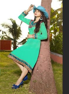 "Designer Wear Georgette Kurti with Santoon lining in Green color with fine embroidery work en-crafted. Length: 38"" and Size: L, XL"