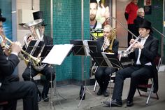 Band in evening dress playing for passengers and spectators at Moorgate Tube station