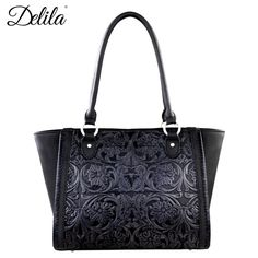 Delila by Montana West, 100% Genuine Leather Tote. - 100% Genuine Leather - Vintage floral tooling on the front - Whipstitch details done by hand - A zipper enclosure entire purse - Inside single comp