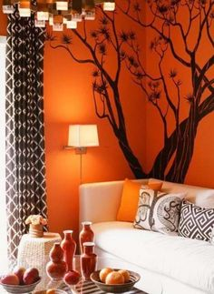 bright orange bedroom wall with teal accents | guest bedroom