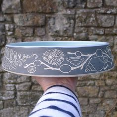 I do enjoy making these shallow bowls, I like to think of them filled with a leafy salad or fresh fruit.....or fresh cream profiteroles with gallons of chocolate sauce poured over! #ceramics #stoneware #sgraffito #seashore #shells #seaweed #servingdish #scottishpotter #makersgonnamake #handmade #craft #maker #makersmark #makersmovement #slowliving #notadogbowl