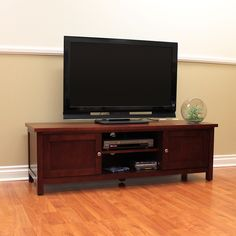 Add Elegance To Your Entertainment System With This Chic Cherry TV Stand. The  Stand Features Two Closed Storage Spaces And One Adjustable Center Shelf  For ...