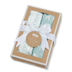 Set of two woven bamboo-blend swaddle blankets come gift-packaged in kraft box tied with grosgrain bow.