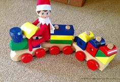 Elf on the Shelf Ideas Train Toot Toot! Ninnin must have been watching Buddy when he was playing with his favourite train. She decided to have a go herself (I must admit she makes less mess than Buddy!)