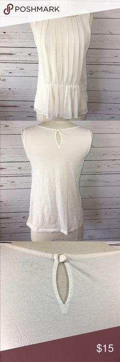 Ann Taylor Loft Sleeveless Blouse NWOT Ann Taylor Loft ivory Sleeveless Blouse with front pleating. Materials: body 100% cotton, panel 100% polyester LOFT Tops Tank Tops