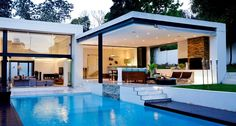 Stock Tank Swimming Pool Ideas, Get Swimming pool designs featuring new swimming pool ideas like glass wall swimming pools, infinity swimming pools, indoor pools and Mid Century Modern Pools. Find and save ideas about Swimming pool designs. Swimming Pool House, Swimming Pool Designs, Swimming Pools, Indoor Swimming, Flat Roof House Designs, Modern Patio Design, Contemporary Design, Moderne Pools, Dream House Exterior