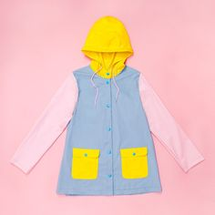 rain rain, please don't go away...so that we can wear this adorable raincoat all day every day! this plastic raincoat by golden ponies is making all of our color blocking dreams come true. the details