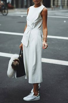 SPRING 2016 15 Outfits to Wear with Your New White Sneakers via @PureWow CULOTTES Whether in jumpsuit- or just pant form, the wide legs love a slim shoe.