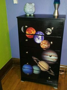 Decoupaged dresser with solar system poster.
