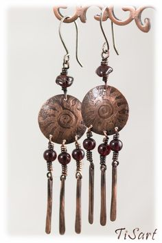 Long, drop copper earrings with Garnet cabochon.  All metal parts of these earrings were hand cut from copper and soldered. Slightly oxidized for a warm, antique look, polished for contrast. A light coating of jewelers lacquer was applied to preserve the patina finish. The earwires are sterling silver (0.8mm).    Earrings will be packed in a gift small box.