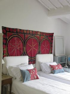 Tapestry hung behind adds bold color and interest