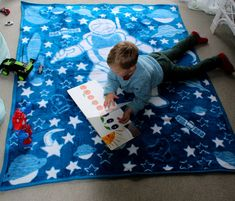 Bright blue and bright white boys blanket! Little boys can have sweet adventurous dreams of being a Picnic Blanket, Outdoor Blanket, Kids Blankets, White Boys, Astronaut, Little Boys, Adventure Kids, Wonderland, Kids Rugs
