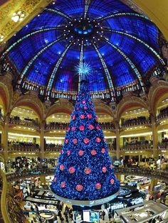 A giant Christmas tree stands in the middle of the Galeries #Lafayette department store in #Paris, pic: Reuters/Charles Platiau