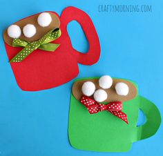 Make a fun hot cocoa mug craft with your kids! It's the perfect winter/christmas art project to make using pom poms as the marshmallows.
