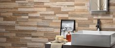 Create a natural look in your kitchen or bathroom with the Grove range of porcelain wall tiles. These wood effect tiles have a split-face style finish that suits a range of decor styles. Ceramic Tile Art, Porcelain Tile, Court Circuit, Taupe Walls, Flatscreen, Wooden Cubes, Feature Tiles, Travertine Tile, Lucca