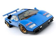This Lamborghini Countach LP500S `Walter Wolf` Diecast Model Car is Blue and features working steering, suspension, wheels and also opening bonnet, boot with engine, doors. It is made by Kyosho and is 1:18 scale (approx. 24cm / 9.4in long).  ...