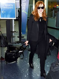 A smiling Jessica Chastain lands at LAX on Thursday ahead of Sunday's Golden Globes. The star is up for Best Supporting Actress in a Motion Picture for A Most Violent Year, but recently revealed she still has to find a dress!