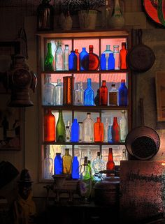 Great collection of old bottles - placing them in the window like this allows light to shine through bringing out the best in each one!