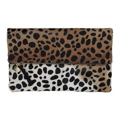 The Leopard Hair-On Foldover Clutch is made of soft calf-hair and has a luxe feel and can act as a neutral against any outfit. Our leopard pattern is printed on