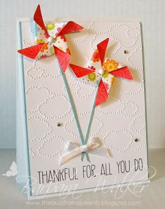 The Buzz: Thankful For All You Do. Featuring the pinwheel die, cloudy day embossing folder, Whisper White and Baja Breeze card stock, plus rhinestones.