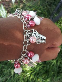 Breast Cancer Awareness Charm Bracelet Love this pretty bracelet and all for a great cause.