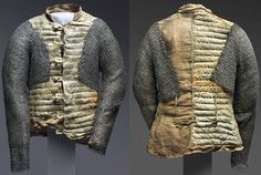 European arming doublet, 1550-1650, repaired c. 1937 by Leonard Heinrich. Leather, linen, flax fiber, steel, and brass. Center Back Length: 25 1/4 inches (64.1 cm) Waist: 36 1/2 inches (92.7 cm) 9 lb. (4.08 kg) Philadelphia museum of Art. Gallery 246, Arms and Armor, second floor (Kretzschmar von Kienbusch Galleries) Bequest of Carl Otto Kretzschmar von Kienbusch, 1977.