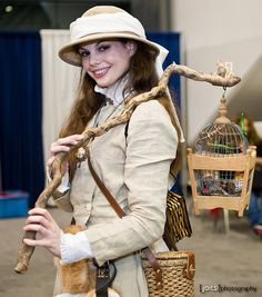 Steampunk apiarist with a beehive and bee netting instead?