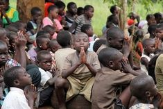 Uganda children praying.