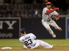 Game #14, 4/19/2012: Philadelphia Phillies shortstop Jimmy Rollins hurdles the sliding San Diego Padres' Yonder Alonso while relaying to first to complete a double play in the ninth inning of the Phillies 2-0 victory in a baseball game Thursday, April 19, 2012 in San Diego. (AP Photo/Lenny Ignelzi)