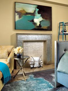 This transitional yellow room is dotted with teal throughout the space.  Style On Picture Lifestyle
