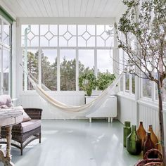 Hammock on a glass porch in a newly built house at the turn of the century. Indoor Window Boxes, Decorative Water Fountain, Glass Porch, Outdoor Rooms, Outdoor Decor, Sunroom Furniture, Sunroom Decorating, Outdoor Ceiling Fans, Deco Design