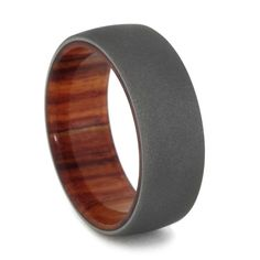 Tulip wood wedding bands are a natural way to symbolize your everlasting bond with one another. This titanium wedding band is laced with an incredible tu...