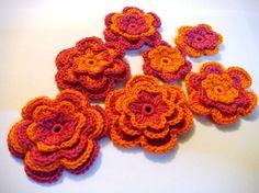 Set of crocheted applique orangepink flowers by MotivesAndPatterns, $7.99