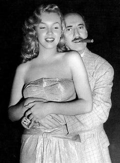 Groucho Marx and Marilyn Monroe on the set of Love Happy (1949).
