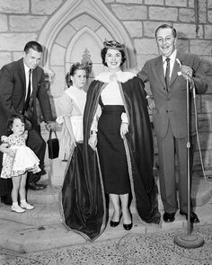 In April 1957, Walt Disney invited Shirley Temple to oversee the opening of the Sleeping Beauty Castle Diorama. Her daughters Lori and Linda can be seen in the background, along with her husband, Charles Black.