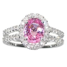 Oval pink sapphire halo diamond ring. Double banded ring with diamonds on the side. Classy and elegant.