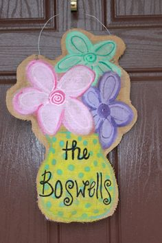 Spring flowers burlap door hanger by ReTellTherapy on Etsy, $30.00