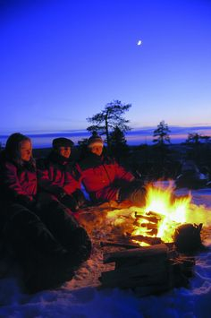 Around a warming campfire in Finland in Winter