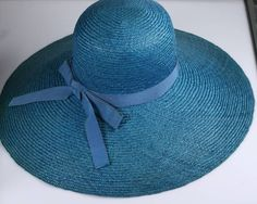 Oooh la la! And in my favorite color!--CH///Hubert de Givenchy Straw Hat | From a collection of rare vintage hats at https://www.1stdibs.com/fashion/accessories/hats/