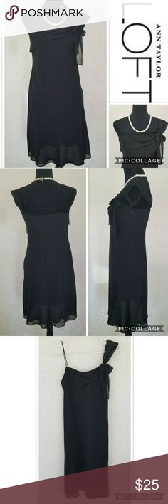 """EUC Ann Taylor LOFT Black Cocktail Dress Sheer, lined flowy mid-rise dress. One shoulder tie(shown in the last photo), slim strap on other shoulder. Concealed zip and hook & eye closure on the left side. In EXCELLENT pre-owned CONDITION. No holes. No stains. No marks. Non-smoking home. Feel free to ask.  Approx.  Laid flat Measurements: Length - 29 1/2"""" (pit to bottom hem) Pit to Pit - 17"""" LOFT Dresses"""
