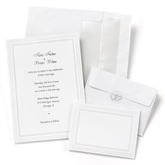 Triple Pearl Border Wedding Invitation Kit includes 50 of each: invitations, RSVP cards, envelopes for each, and clear seals with silver foil hearts. Both the invitations and the RSVP cards are made of white cardstock with a triple pearlized border. The envelopes are lined with silver to coordinate.